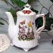 567-120 - Butterfly w/Hollyhock 2C Antique Teapot